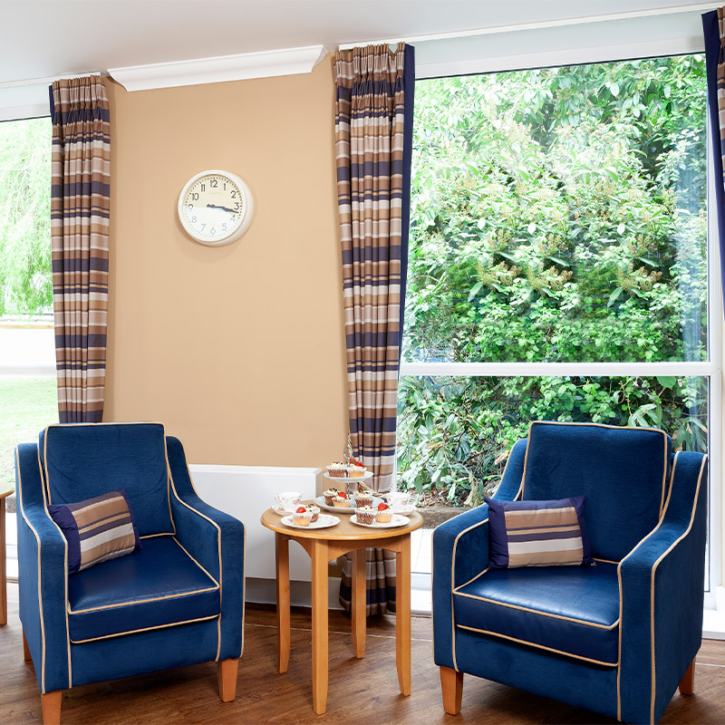 blue chairs in living room space at Oaklands Care Centre Southampton