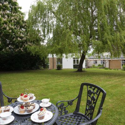 garden view with cupcakes on table of Oaklands Care Centre Southampton